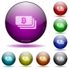 Bitcoin banknotes glass sphere buttons - Set of color Bitcoin banknotes glass sphere buttons with shadows.