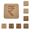 Indian rupee sign wooden buttons - Set of carved wooden Indian rupee sign buttons in 8 variations.