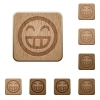 Laughing emoticon wooden buttons - Set of carved wooden Laughing emoticon buttons in 8 variations.