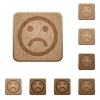 Sad emoticon wooden buttons - Set of carved wooden sad emoticon buttons in 8 variations.
