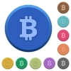 Embossed bitcoin sign buttons - Set of round color embossed bitcoin sign buttons