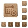 Calendar alarm wooden buttons - Set of carved wooden calendar alarm buttons in 8 variations.