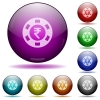 Indian Rupee casino chip glass sphere buttons - Indian Rupee casino chip color glass sphere buttons with shadows.