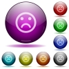 Sad emoticon glass sphere buttons - Sad emoticon color glass sphere buttons with shadows.