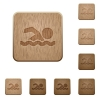 Swimming man wooden buttons - Swimming man on rounded square carved wooden button styles