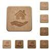 Home insurance wooden buttons - Home insurance on rounded square carved wooden button styles