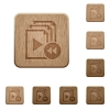Playlist fast backward wooden buttons - Playlist fast backward on rounded square carved wooden button styles
