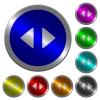 Horizontal control arrows luminous coin-like round color buttons - Horizontal control arrows icons on round luminous coin-like color steel buttons