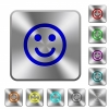 Smiling emoticon rounded square steel buttons - Smiling emoticon engraved icons on rounded square glossy steel buttons