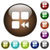 Component fast backward color glass buttons - Component fast backward white icons on round color glass buttons