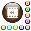 Movie fast backward color glass buttons - Movie fast backward white icons on round color glass buttons
