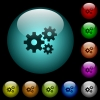 Gears icons in color illuminated glass buttons - Gears icons in color illuminated spherical glass buttons on black background. Can be used to black or dark templates