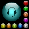 Headset with microphone icons in color illuminated glass buttons - Headset with microphone icons in color illuminated spherical glass buttons on black background. Can be used to black or dark templates