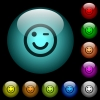 Winking emoticon icons in color illuminated spherical glass buttons on black background. Can be used to black or dark templates - Winking emoticon icons in color illuminated glass buttons