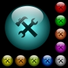 Wrench and hammer icons in color illuminated spherical glass buttons on black background. Can be used to black or dark templates