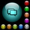Chat bubbles icons in color illuminated glass buttons - Chat bubbles icons in color illuminated spherical glass buttons on black background. Can be used to black or dark templates