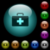 First aid kit icons in color illuminated glass buttons - First aid kit icons in color illuminated spherical glass buttons on black background. Can be used to black or dark templates