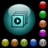 Play files icons in color illuminated glass buttons - Play files icons in color illuminated spherical glass buttons on black background. Can be used to black or dark templates