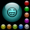 Laughing emoticon icons in color illuminated glass buttons - Laughing emoticon icons in color illuminated spherical glass buttons on black background. Can be used to black or dark templates
