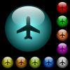 Airplane icons in color illuminated glass buttons - Airplane icons in color illuminated spherical glass buttons on black background. Can be used to black or dark templates