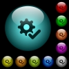 Settings ok icons in color illuminated glass buttons - Settings ok icons in color illuminated spherical glass buttons on black background. Can be used to black or dark templates