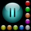 Media pause icons in color illuminated glass buttons - Media pause icons in color illuminated spherical glass buttons on black background. Can be used to black or dark templates