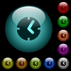 Clock icons in color illuminated glass buttons - Clock icons in color illuminated spherical glass buttons on black background. Can be used to black or dark templates