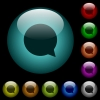 Blank chat bubble icons in color illuminated glass buttons - Blank chat bubble icons in color illuminated spherical glass buttons on black background. Can be used to black or dark templates