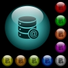 Database email icons in color illuminated glass buttons - Database email icons in color illuminated spherical glass buttons on black background. Can be used to black or dark templates