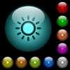 Brightness control icons in color illuminated glass buttons - Brightness control icons in color illuminated spherical glass buttons on black background. Can be used to black or dark templates