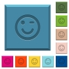 Winking emoticon engraved icons on edged square buttons in various trendy colors - Winking emoticon engraved icons on edged square buttons
