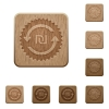New Shekel pay back guarantee sticker on rounded square carved wooden button styles