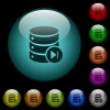 Database macro next icons in color illuminated glass buttons - Database macro next icons in color illuminated spherical glass buttons on black background. Can be used to black or dark templates