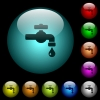 Water faucet with water drop icons in color illuminated glass buttons - Water faucet with water drop icons in color illuminated spherical glass buttons on black background. Can be used to black or dark templates