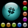 Four leaf clover icons in color illuminated spherical glass buttons on black background. Can be used to black or dark templates - Four leaf clover icons in color illuminated glass buttons