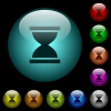Hourglass icons in color illuminated glass buttons - Hourglass icons in color illuminated spherical glass buttons on black background. Can be used to black or dark templates
