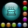 Birthday cake icons in color illuminated spherical glass buttons on black background. Can be used to black or dark templates