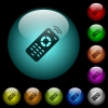 Working remote control icons in color illuminated glass buttons - Working remote control icons in color illuminated spherical glass buttons on black background. Can be used to black or dark templates