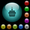 Birthday cupcake icons in color illuminated glass buttons - Birthday cupcake icons in color illuminated spherical glass buttons on black background. Can be used to black or dark templates
