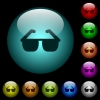Sunglasses icons in color illuminated glass buttons - Sunglasses icons in color illuminated spherical glass buttons on black background. Can be used to black or dark templates