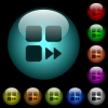 Component fast forward icons in color illuminated glass buttons - Component fast forward icons in color illuminated spherical glass buttons on black background. Can be used to black or dark templates