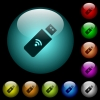 Wireless usb stick icons in color illuminated glass buttons - Wireless usb stick icons in color illuminated spherical glass buttons on black background. Can be used to black or dark templates