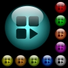 Component play icons in color illuminated glass buttons - Component play icons in color illuminated spherical glass buttons on black background. Can be used to black or dark templates