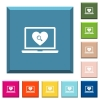 Online Dating on laptop white icons on edged square buttons - Online Dating on laptop white icons on edged square buttons in various trendy colors