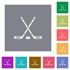 Hockey sticks with puck square flat icons - Hockey sticks with puck flat icons on simple color square backgrounds