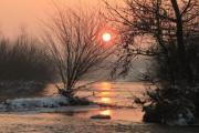 Sunset by the winter river - Riverside sunset