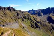 Peaks of a mountain range, shone by the morning sun. - Arid rocks