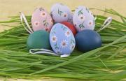 A collection of colorful Easter eggs in grass nest - Colorful Easter eggs