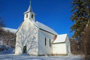 Little white church standing in the winter sunshine - White church