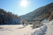 Sunny winter valley with a snowy road - Sunny winter valley